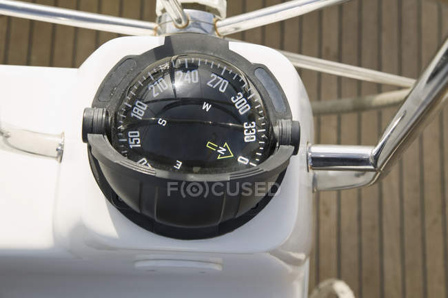 Directly above view of compass on yacht — Stock Photo