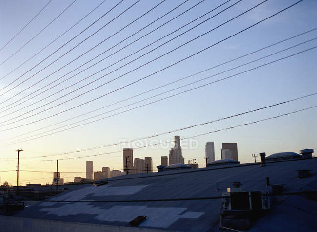View to sunrise sky over downtown district skyline — Stock Photo