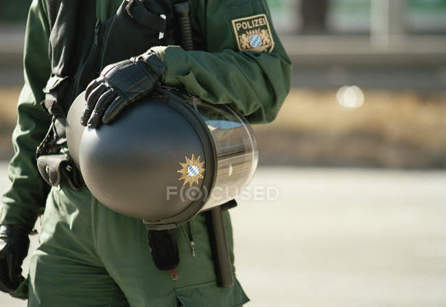 Midsection of police officer wearing protective clothing at street — Stock Photo