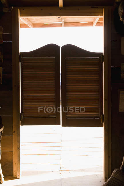 Full frame shot of doorway with saloon doors — Stock Photo