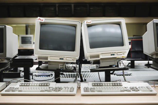 Two old computers with 'Fired' lables — Stock Photo