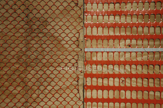 Orange plastic construction netting — Stock Photo