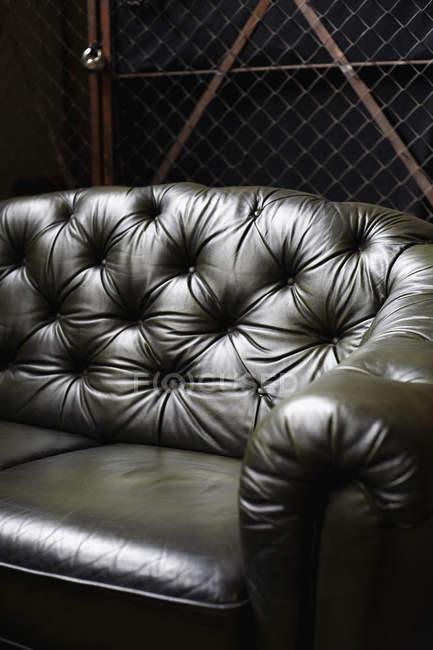 Crop black luxury leather sofa — Stock Photo