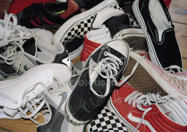 Full frame shot of heap of trainers shoes — Stock Photo