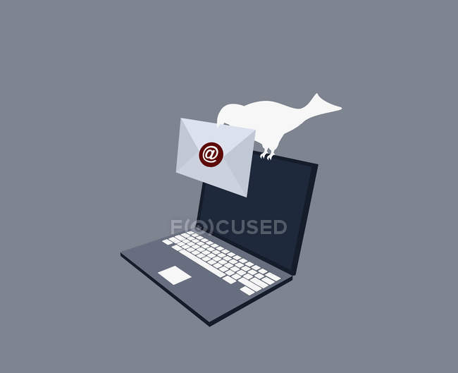 Bird sitting on top of laptop and carrying envelope — Stock Photo