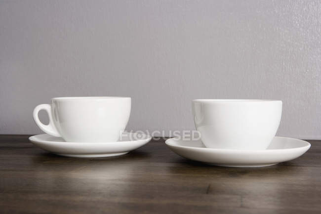 Two white ceramic cups  on table — Stock Photo