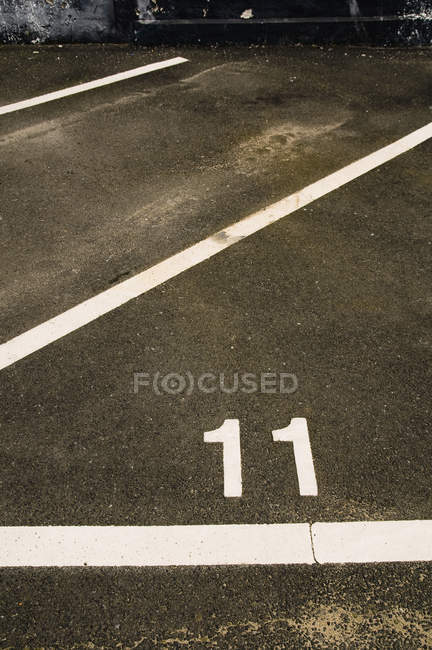 Car parking space and digits on asphalt — Stock Photo