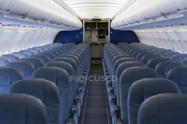 Interior of airplane with rows of empty seats — Stock Photo