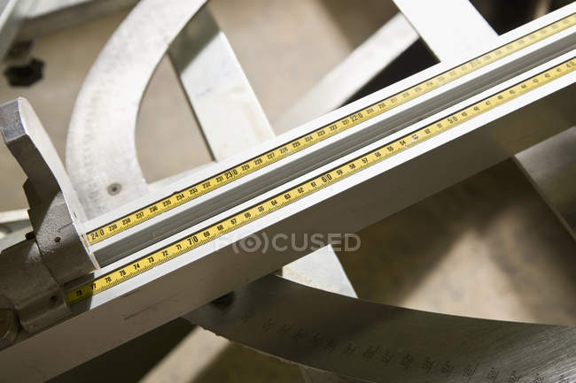 Close up view of sliding ruler on counter — Stock Photo