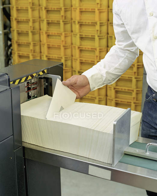 Crop person sorting envelopes at mail office — Stock Photo