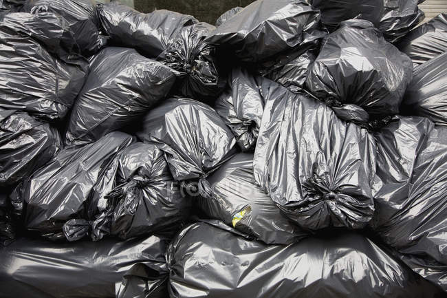 Full frame shot of pile of black rubbish bags — Stock Photo
