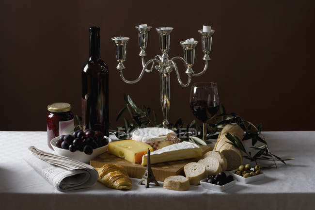 Still life of stereotypical French cuisine with ornate candelabra — Stock Photo