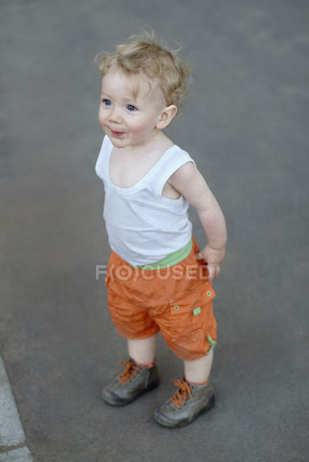 A young boy standing in anticipation — Stock Photo