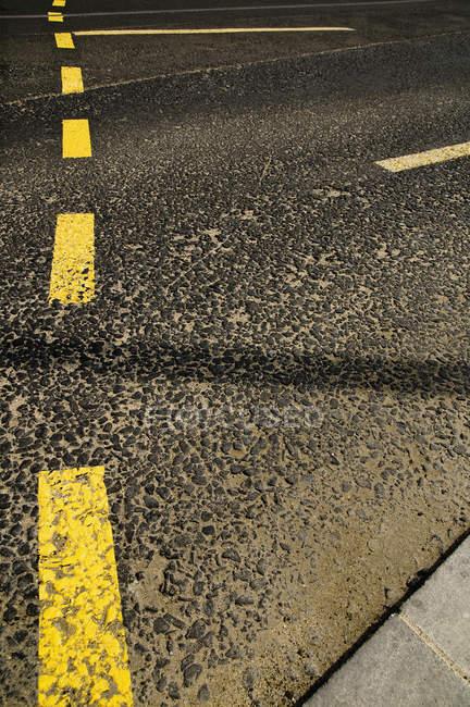 Detail of roads markings on an asphalt road — Stock Photo