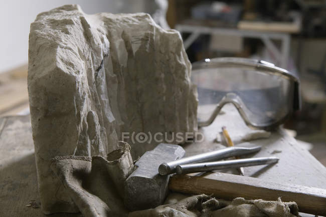 Still life of tools and material at sculpture workshop — Stock Photo