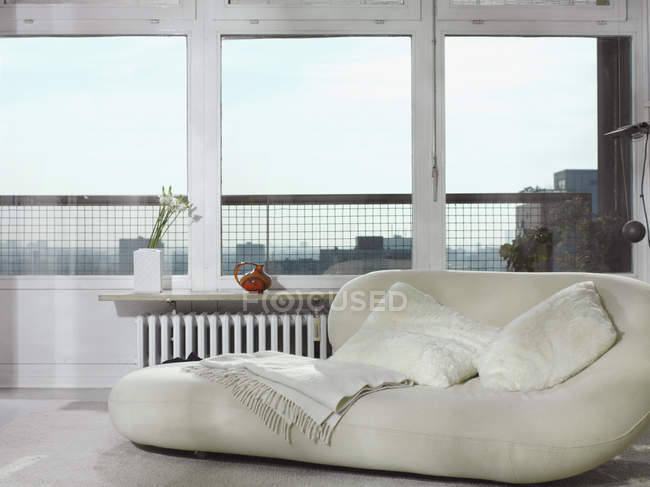 Interior view of beanbag by window — Stock Photo