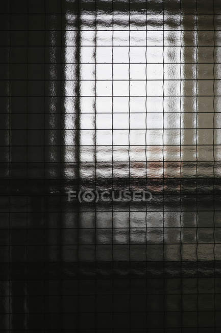 Close up view of reinforced glass window — Stock Photo