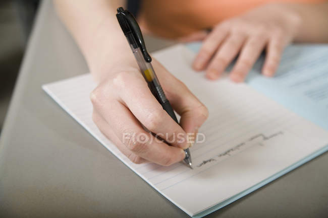 Person writing in notebook — Stock Photo