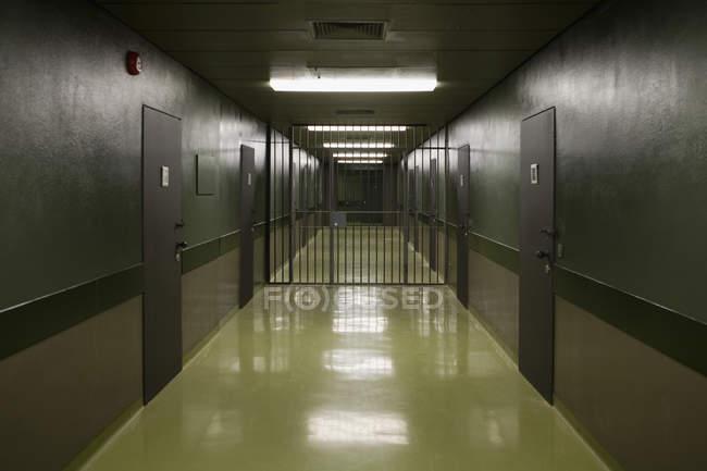Interior of empty prison corridor — Stock Photo