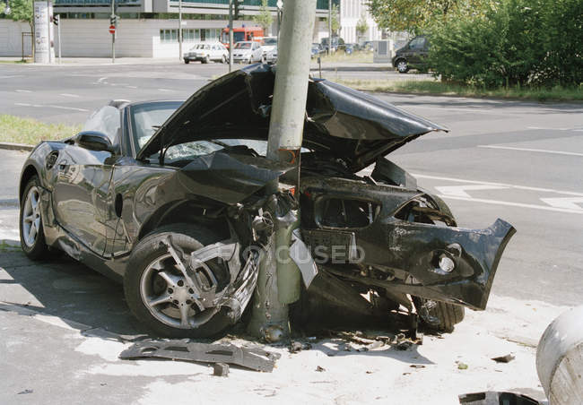 Front view of car crashed into lamp post — Stock Photo