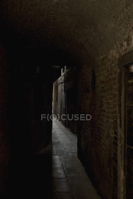 View to dark alleyway at old town — Stock Photo