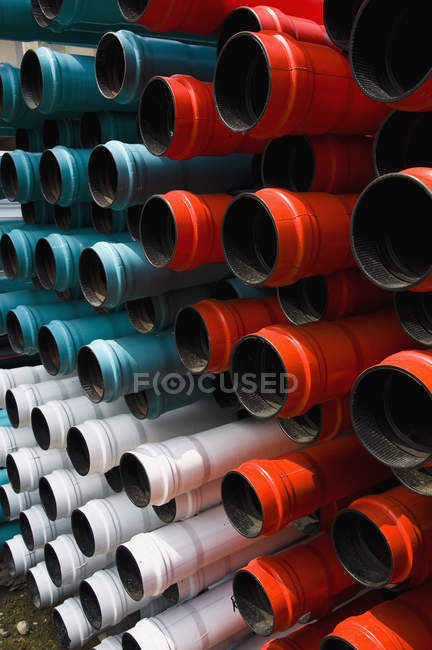 Full frame shot of stacked plastic tubes — Stock Photo