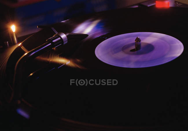 Close up view of vinyl record playing on turntable — Stock Photo