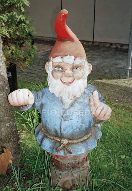 Garden Gnome figurine at grassy yard — Stock Photo