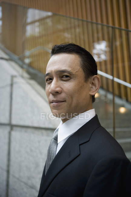 Portrait of  businessman looking at camera — Stock Photo