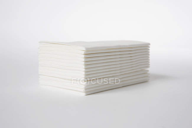 Stack of white tissues on white background — Stock Photo