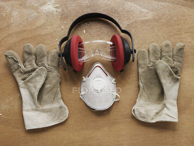Protective workwear arranged on bench — Stock Photo