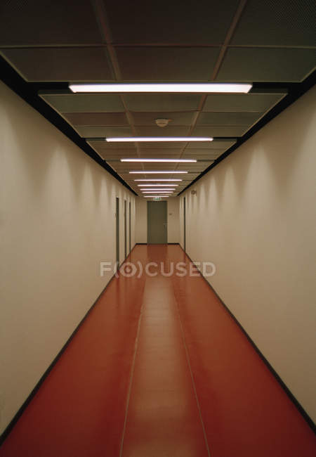 Interior view of long and empty hallway — Stock Photo