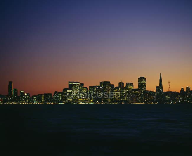 Illuminated cityscape at dusk, San Francisco, California, USA — Stock Photo
