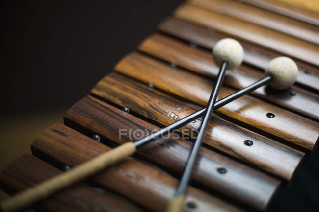 Close up view of mallets arranged on xylophone — Stock Photo