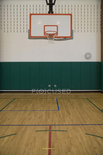 Interior view of sports hall with basketball hoop — Stock Photo