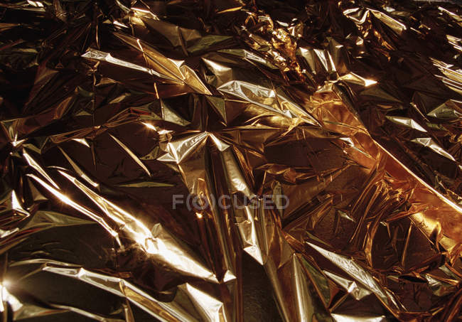 Full frame shot of crumpled gold foil — Stock Photo