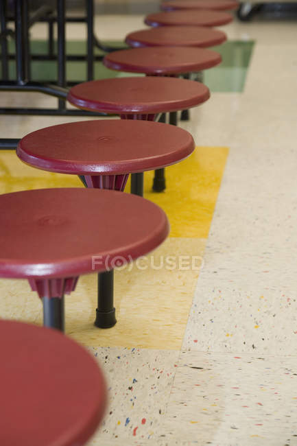 Row of empty stools in school canteen — Stock Photo