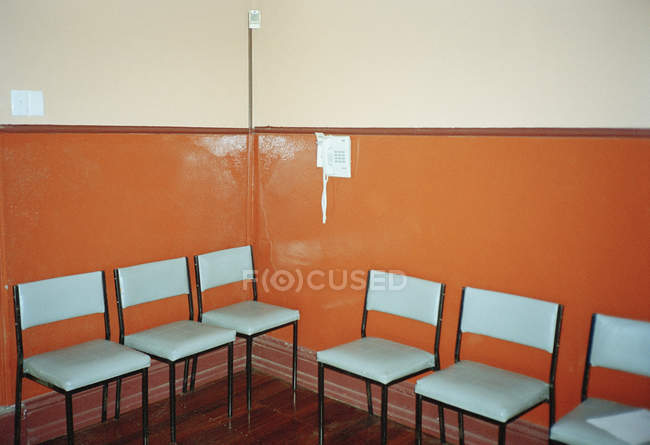Interior of empty waiting room with chairs by walls — Stock Photo