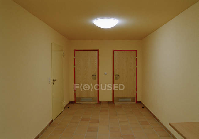 Interior view to empty corridor with two closed doors — Stock Photo