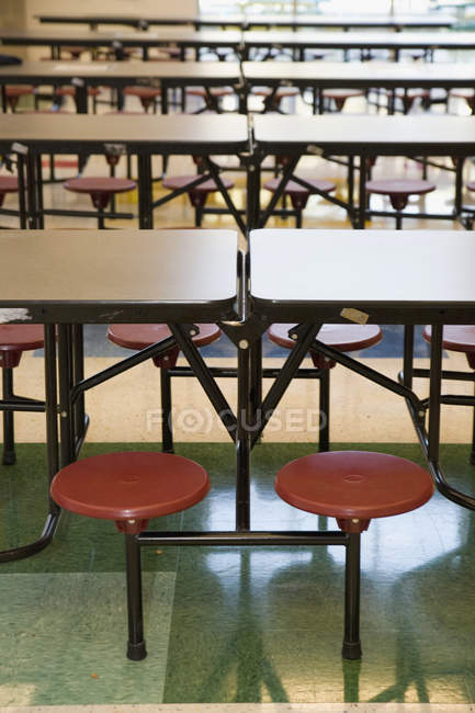 Rows of empty stools and tables in school canteen — Stock Photo