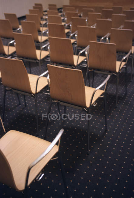 High angle view of empty chairs in rows — Stock Photo