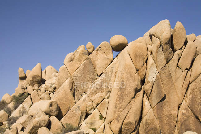 Granite boulders over clear sky on background — Stock Photo