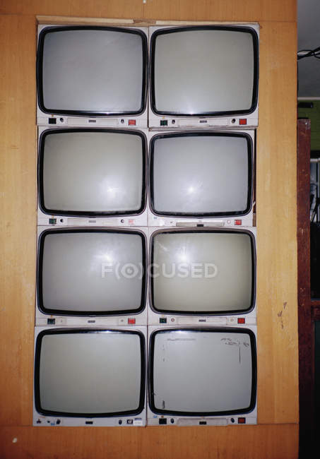 Vintage televisions mounted in wall — Stock Photo