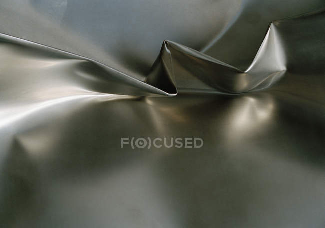 Full frame shot of pleat on twisted aluminum surface — Stock Photo