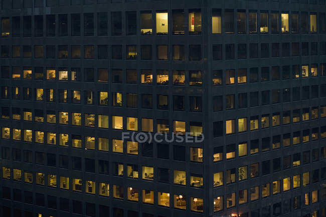 Exterior view of office building at night — Stock Photo