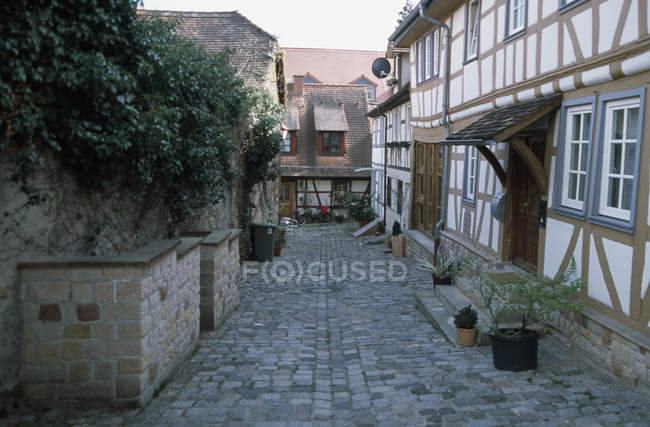 Old fashioned town street with rural facades and cobblestones — Stock Photo