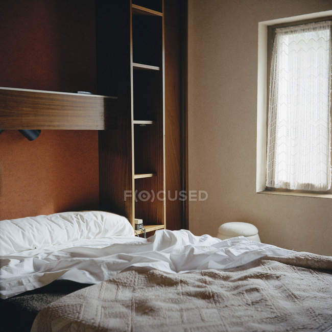 Interior view to bed and shelves at motor home — Stock Photo