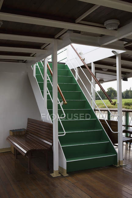 Steps on boat leading to deck above — Stock Photo