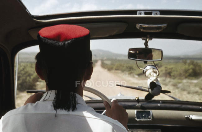 Rear view of taxi driver driving on rural road — Stock Photo