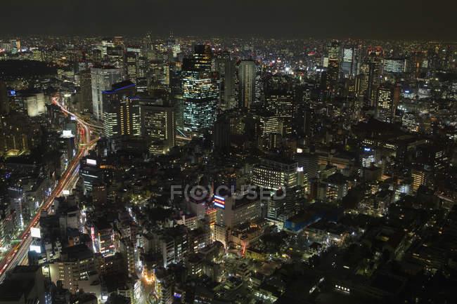 Illuminated facades in cityscape at night — Stock Photo